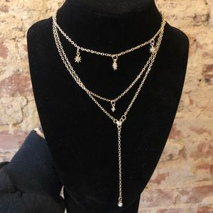 Jewelry - 3/$15 SALE Gold star 3 layer necklace